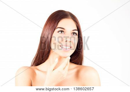 Happy smiling woman with straight red hair touching chin. Skin care concept. Beauty woman.