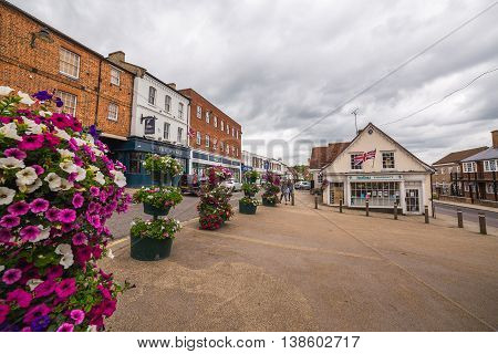 BUCKINGHAM UK - 4TH JULY 2016: A view of Buckingham Town center during the day. People can be seen.