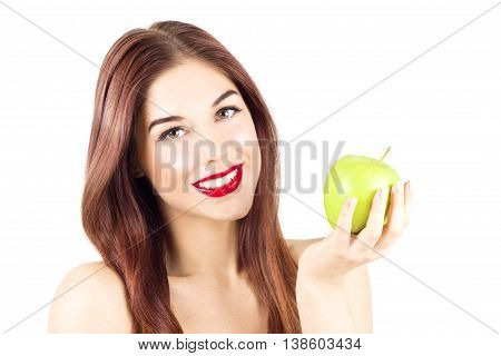 Smiling happy woman with red lips holding a green apple. Woman with smile and healthy and white teeth.