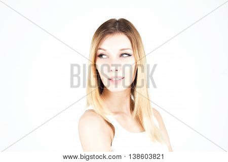 Sensual attractive blonde woman looking away with a smile. Woman with permanent makeup. Arrows on the eyes
