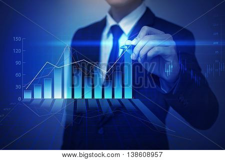 Closeup image of businessman drawing graphbusiness strategy as concept