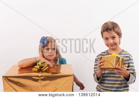 Siblings christmas gifts - the brother is more happy with a smaller gift box than his sister with a big one