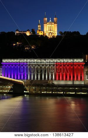 Lyon, France - July 15, 2016: French national colors on the courthouse in Lyon called palais de justice in French in tribute to all victims of terror in Nice, France