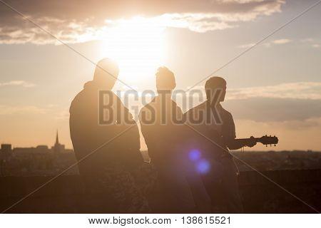 Three Men Music Band Guitar Backlit Strong Lens Flare Sunlight Sun