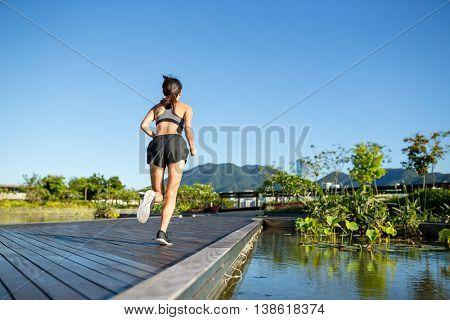 Woman running at borad walk