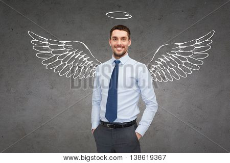 business, angel investor, safety, security and people concept - smiling young businessman with wings and nimbus drawing over gray concrete background poster