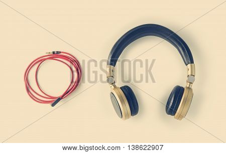 Wired Recording Studio Headphone on white background. Isolated Headphone with copy space. Leather Headphone with golden jack input.