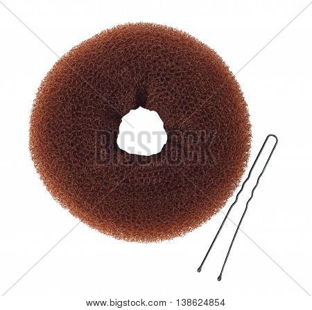 chignon donut bun maker with hairpin isolated on white background top view. Donut for hair style bun