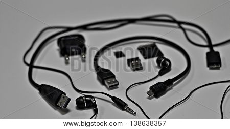 Memory cards, usb connectors, earphone jack plug and wires studio isolated on white