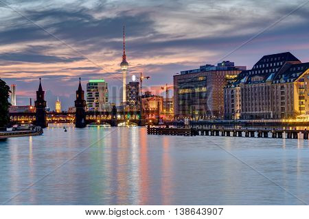 Evening at the river Spree in Berlin with the Television Tower in the back