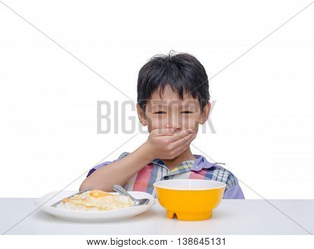 Asian child close his mouth by hand between having lunch