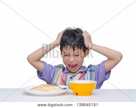 Asian child don't want to eat food for lunch