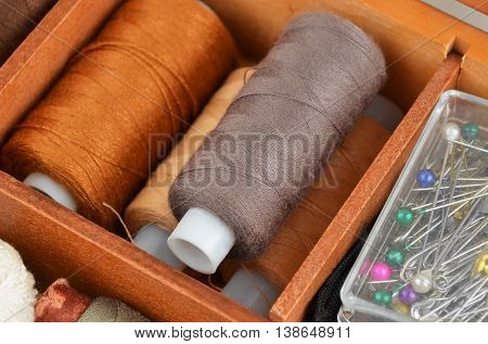 Threads On Wooden Box