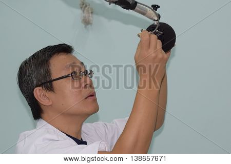 An acoustic engineer testing the audio setup