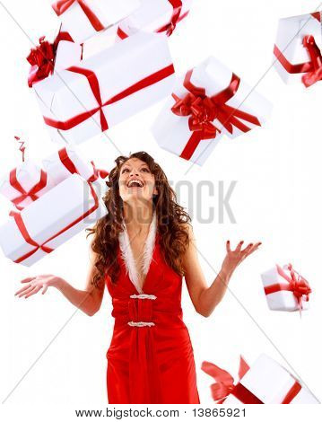 Excited attractive woman with many gift boxes and bags.