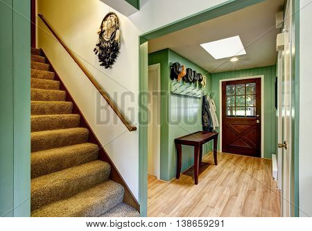 Green Entryway Of Country House With Hardwood Floor And Skylight.