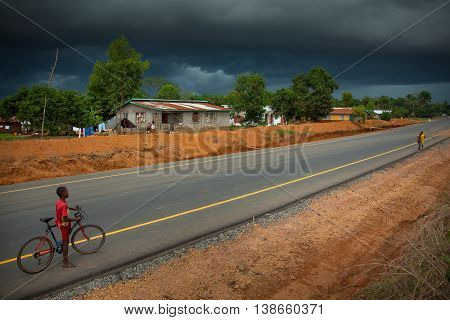 Yongoro Sierra Leone - June 02 2013: West Africa the village of Yongoro in front of Freetown rainstorm