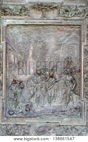 PISA, ITALY - JUNE 06, 2015: Judas' betrayal, artwork from the school of Giambologna, panel from the bronze door on the righ of the Cathedral St. Mary of the Assumption in Pisa, Italy on June 06, 2015