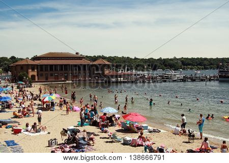 Lake Geneva WI - July 03: Lake Geneva on July 03 2016 in Wisconsin. People rest on the beach Lake Geneva in Wisconsin USA.