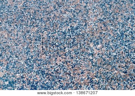 Texture of natural treated black and brown spotted granite