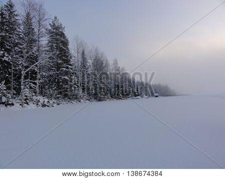 Wintery snow scene on a frozen lake.