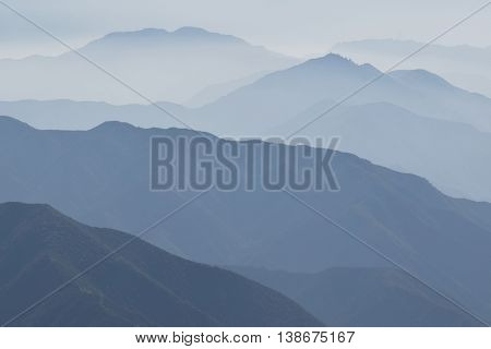 Haze surrounding mountain ridges taken in the San Gabriel Mountains, CA which is a typical Southern California weather pattern