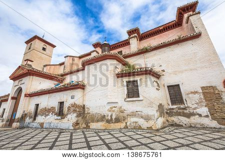 Iglesia de San Nicolas is located in the historic district of Albaicin of Granada in Andalusia, Spain and is popular for the Mirador de San Nicolas with a spectacular view of Alhambra de Granada.