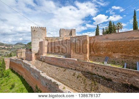 The military fortress wall of the Alcazaba in Alhambra of Granada, Unesco Heritage, Andalusia, Spain.
