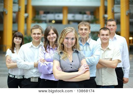 Businesswoman in a office and his team