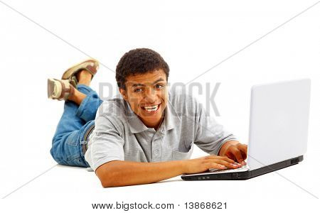 Stock Photo: Portrait of a young African American man using laptop on white background