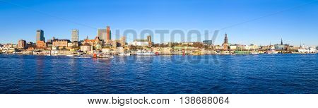 Panoramic view of Hamburg in winter. Blue water of elbe river with pano cityscape.