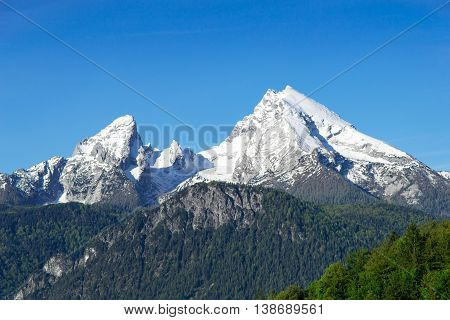 Snow-capped top mountain peaks of Watzmann Mount ridge in German Bavarian Alps. View to highland snowy landscape from high point in national park Berchtesgaden.