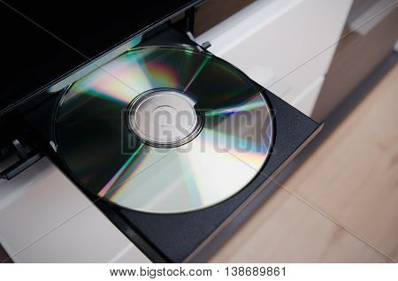 Close up of Blu-ray or DVD player with inserted disc