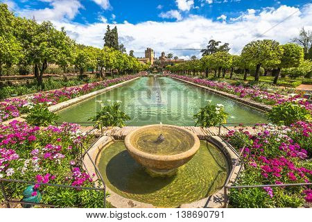 The popular gardens with fountains of Alcazar de los Reyes Cristianos, a medieval building and popular tourist attraction, located in the Andalusian city of Cordoba, Spain.