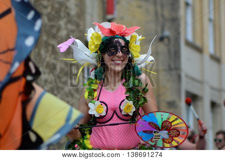 BATH SOMERSET UK - JULY 16 2016 Dancer in pink costume. Bath Carnival procession around the streets of the city of Bath bringing a South American festival atmosphere to Somerset