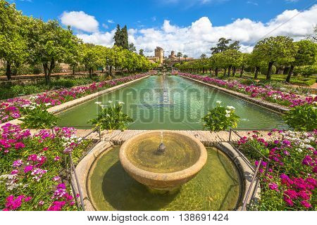 The popular gardens with fountains of Alcazar de los Reyes Cristianos, a popular tourist attraction of Cordoba, Andalusia, Spain. Unesco Heritage Site.