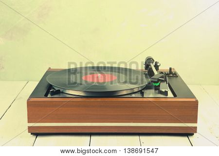 vintage music player turntable with vinyl lp