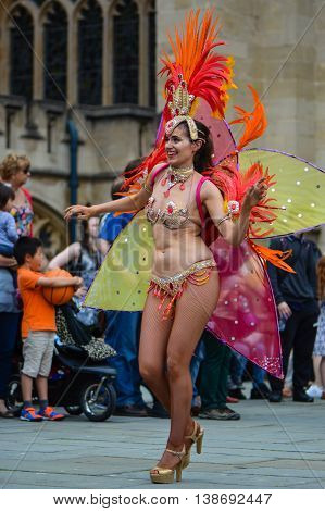 BATH SOMERSET UK - JULY 16 2016  Carnival dancer with feathers. Bath Carnival procession around the streets of the city of Bath bringing a South American festival atmosphere to Somerset