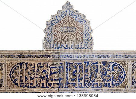 SEVILLE, SPAIN - September 12, 2015: Detail of mudejar perfection in the combination of plant motifs and Arabic inscriptions Alcazar of Seville on September 12, 2015 in Seville, Spain