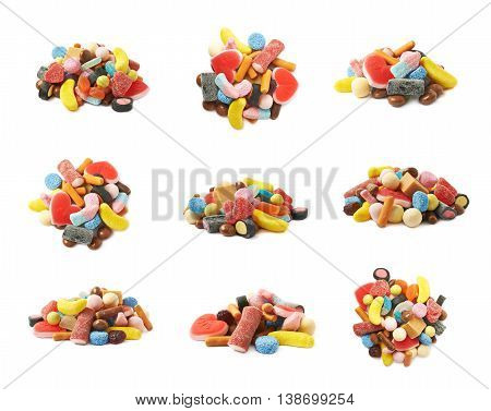 Pile of multiple different colorful candies isolated over the white background, set of nine different foreshortenings