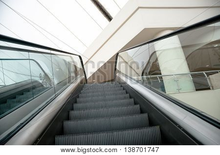 Escalators stairway inside modern mall going up