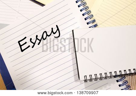 Essay text concept write on notebook .