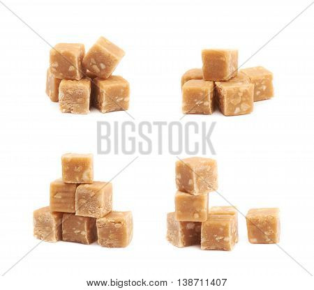 Toffee candy with nuts isolated over the white background, set of four different foreshortenings