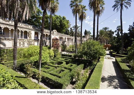 SEVILLE, SPAIN - September 12, 2015: View of the garden and Grotto Gallery (Galeria de Grutesco) in the Alcazar of Seville on September 12, 2015 in Seville, Spain