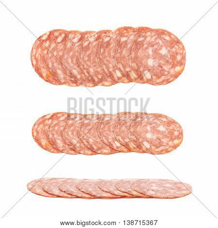 Line of sliced Italian sausage salame napoli isolated over the white background, set of three different foreshortenings