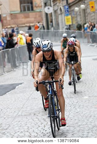 STOCKHOLM - JUL 02 2016: Simone Ackermann and group of female triathlete cyclists cycling downhill on cobblestone in the Women's ITU World Triathlon series event July 02 2016 in Stockholm Sweden