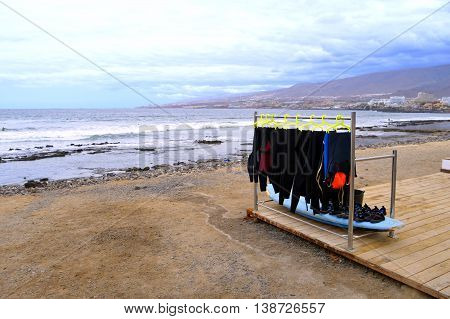 Playa De Las Americas surfing wetsuits on the beach