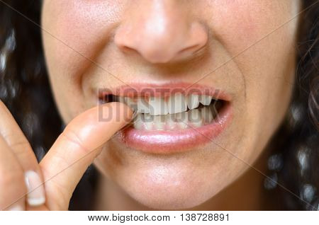 Anxious Young Woman Biting Her Thumb