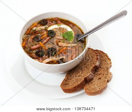 The Soup Solyanka Poured In A White Soup Plate