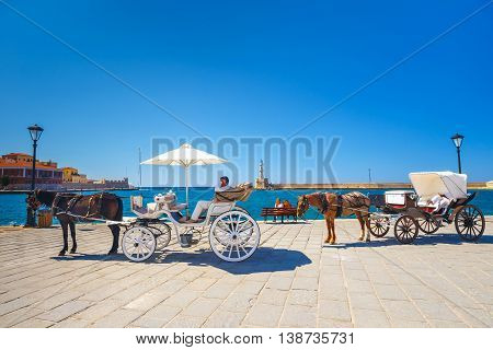 Chania, Crete - 23 Maj, 2016: Horse Carriage For Transporting Tourists In Old Port Of Chania, Greece
